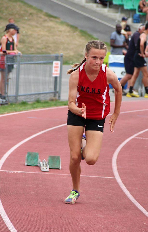 Waitaki Girls High student running on a track