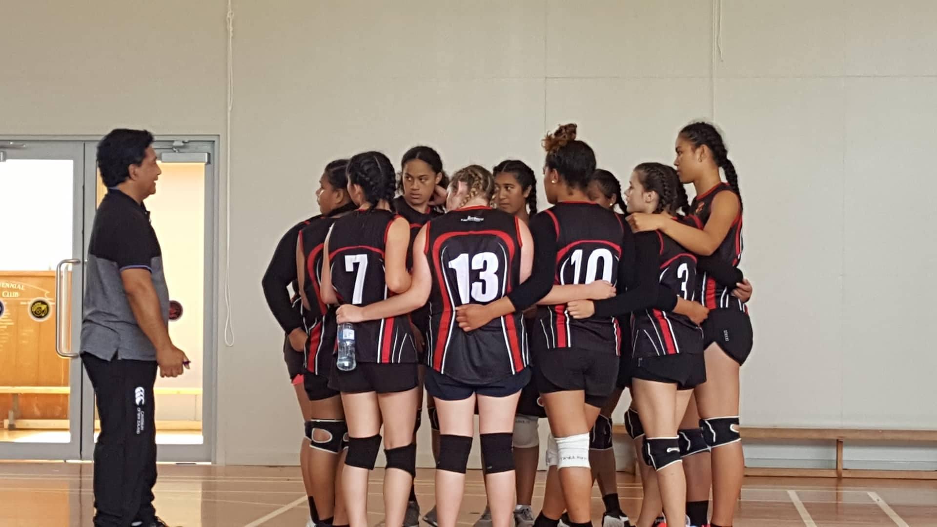 Waitaki Girls High sports team in a huddle
