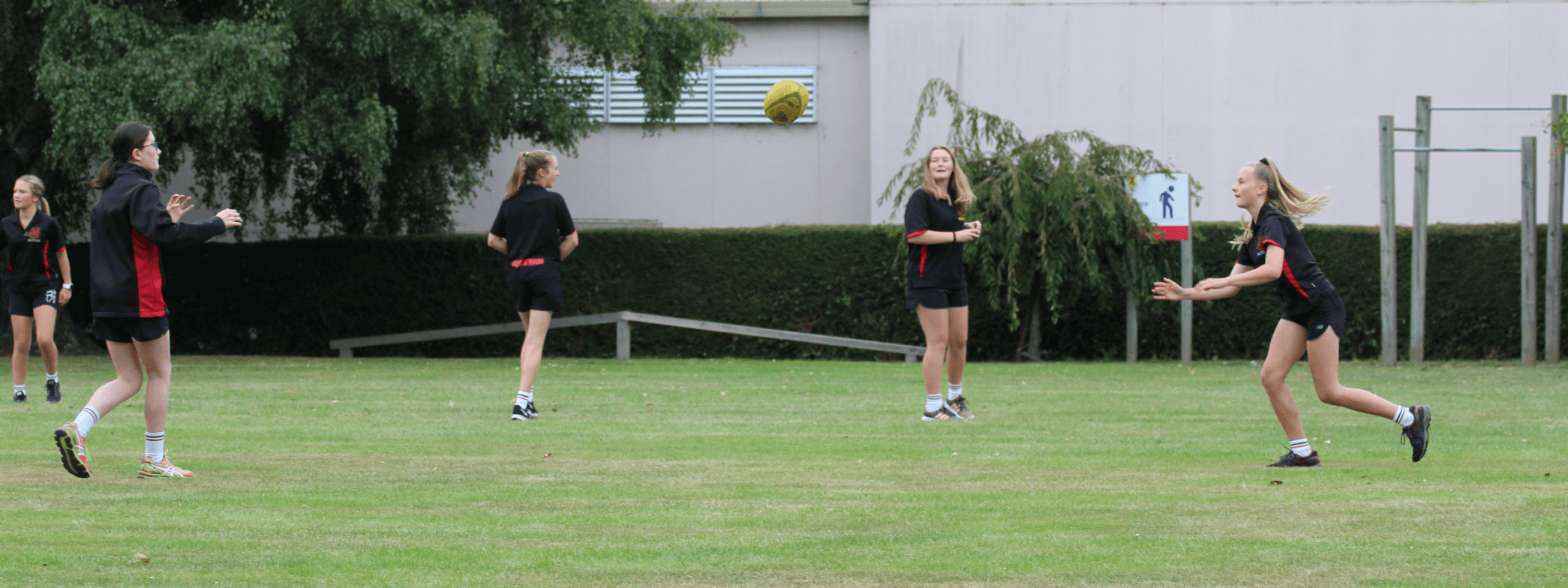 Waitaki Girls High students playing rugby